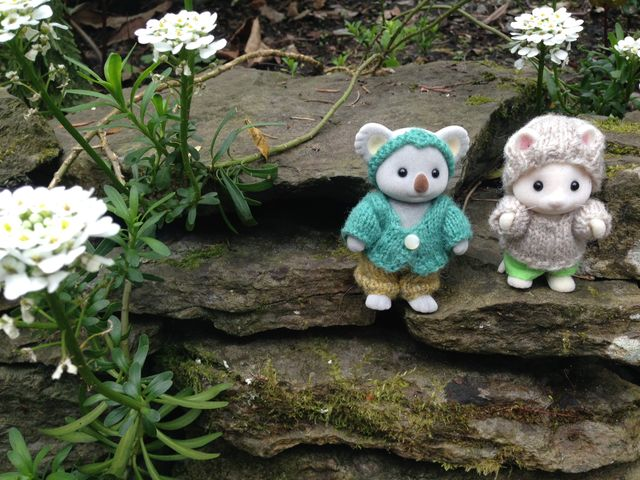 "<a href=""http://www.ravelry.com/patterns/library/playing-in-the-woods-for-sylvanian-families-and-calico-critters"">Playing in the Woods</a> miniature outfits for Calico Critters"
