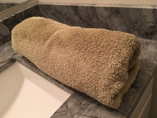 Roll up in the towel and press to remove as much moisture as possible