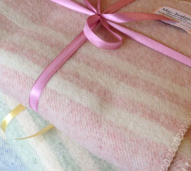 Our lap blankets in soft pastel colours make lovely baby gifts